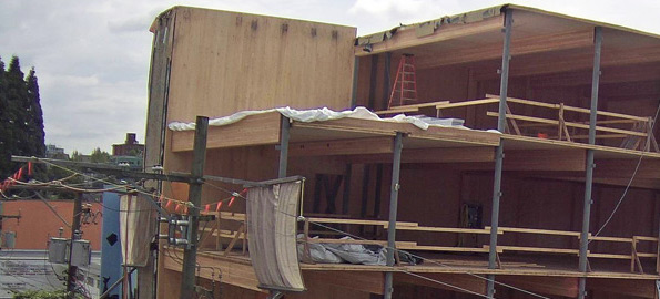multi-story building under construction using timber