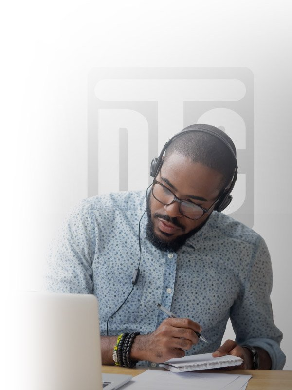 Guy listening at computer DTC logo