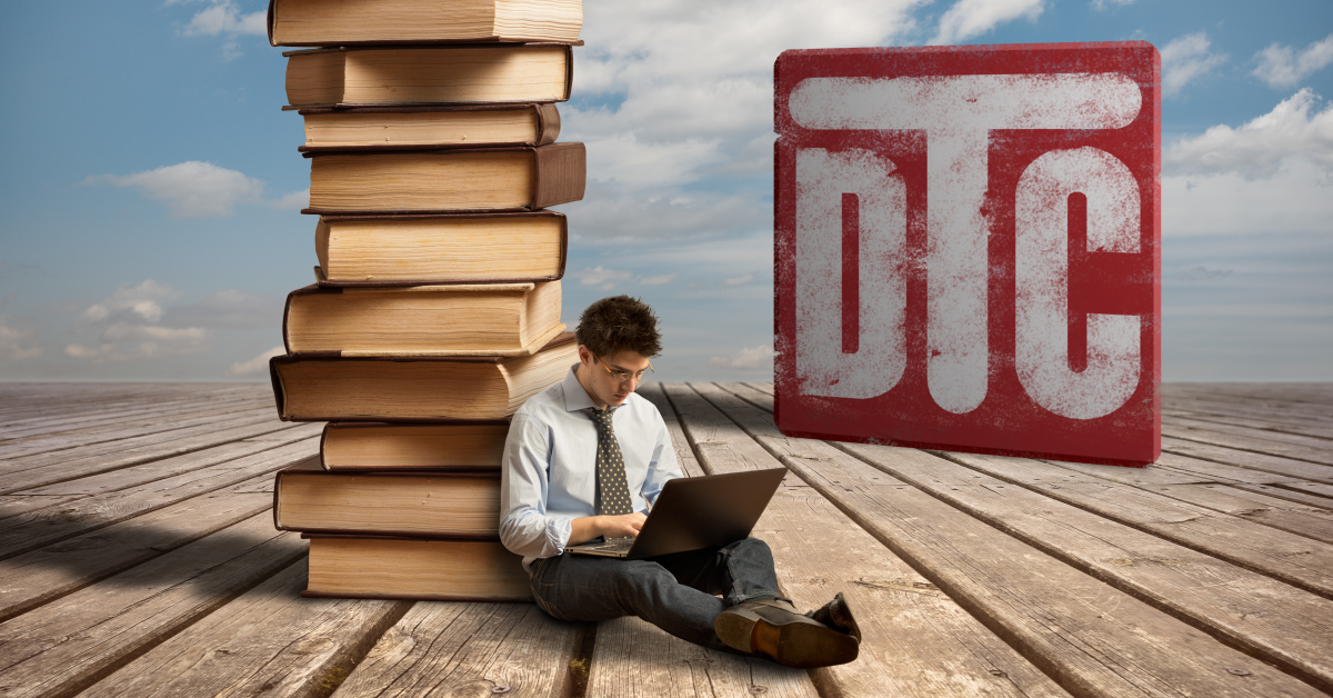 Somewhat surreal image in which a young man with a laptop leans on a pile of oversized books with the DTC logo and blue skies behind him.